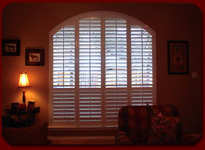 image of arch white shutters